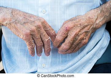 Hands of elderly man - old man with his hands removed...