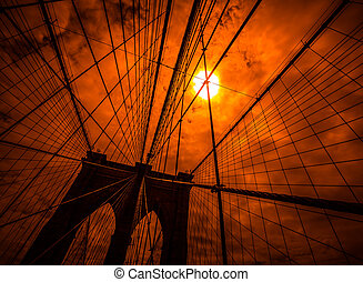 Brooklyn bridge silhouette with a dramatic red sky New York...