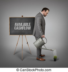 Available cashflow text on blackboard with businessman -...