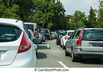 cars in convoy - traffic jam in the journey to the holiday...
