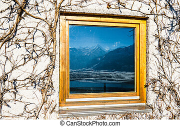 Window with mountain reflection