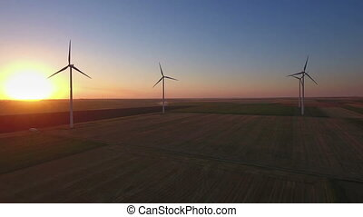 Wind turbines in sunset - Aerial shot of power generating...