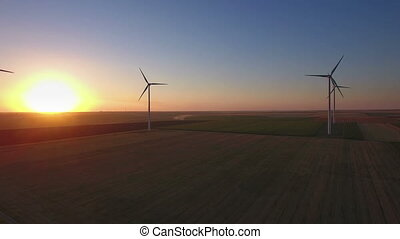 Aerial of wind turbines in field