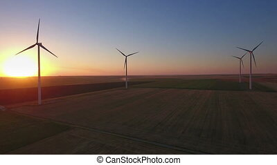 Aerial of wind turbines in field - Aerial view of large wind...
