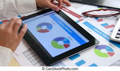 Woman Looks At Stock Statistics - Businesswoman Looks At...