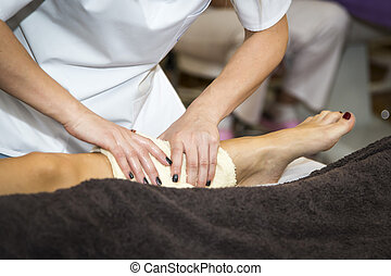 Massaging of young woman