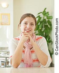 girl sitting in lunchroom - beauty brunette girl sitting in...
