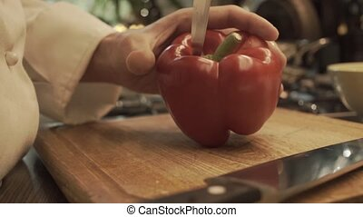 Male hands preparing paprika on a wooden cooking board HD