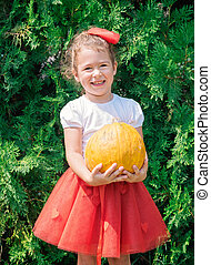 Child holding pumpkin - Portrait of happy kid with pumpkin...