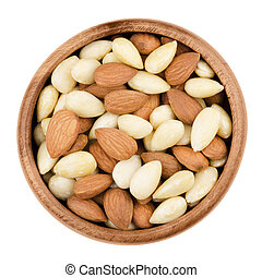 Blanched and shelled almonds in a bowl on white background....