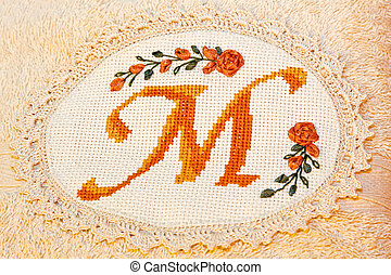 Monogram towel - Detail of monogram towel with m letter
