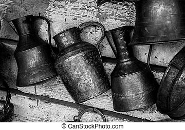 Large old antique copper cans in black and white