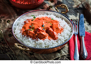 Tasty tikka masala with rice and chicken