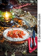 Tasty tikka masala with chicken in tomato sauce