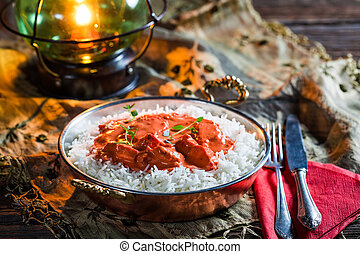 Tasty tikka masala with rice and chicken in tomato sauce