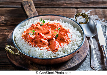 Delicious tikka masala with chicken in tomato sauce