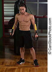 Trx Straps Training - Attractive Man Does Crossfit With Trx...