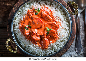 Delicious tikka masala with rice and sauce