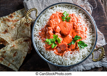 Indian tikka masala with rice and tomato sauce