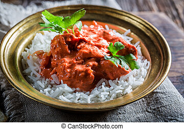Spicy tikka masala with rice and chicken