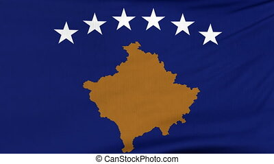 National flag of Kosovo flying on the wind - National flag...