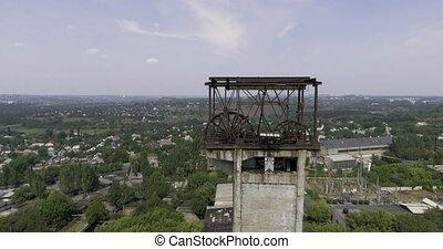 mine elevator wheel under working aerial shot