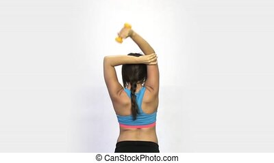 Girl does exercise with dumbbells back view HD