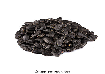 Heap of black sunflower seeds isolated on a white background