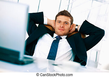 Relax. - Young businessman sitting relaxed in his chair with...