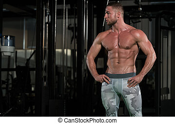 Healthy Young Man Flexing Muscles - Portrait Of A Young...