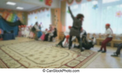 Children tug rope in the hall of the kindergarten - Children...