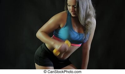 Wet girl is engaged with dumbbells HD
