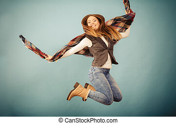 Attractive woman is jumping up - Movement fun and fashion...