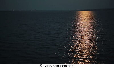 Light reflections in the water at night - Moonlight path...