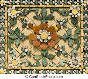Old floral, ceramic tile in Grand Palace, Thailand