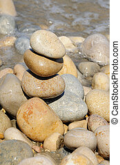 zen stones on a seashore