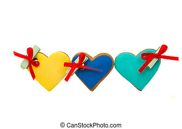 Cookies heart with wishes on a white background