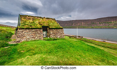 Cottage covered with grass on the roof in Iceland