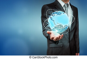 Close up of businessman holding digital globe on his palm