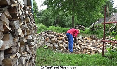 Gardener man with hat prepare natural wood fuel and rural...