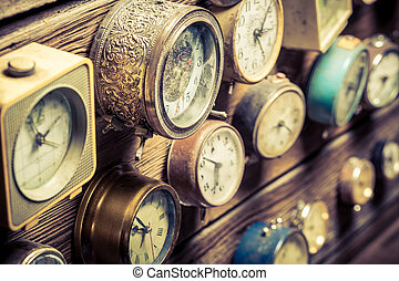 Vintage wall with clocks