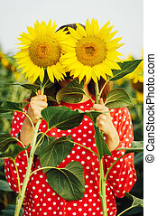 Sensual portrait of a girl in a sunflower field. Portrait of...