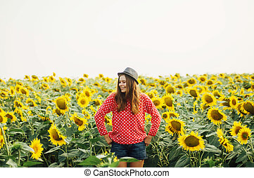Sensual portrait of a girl in a sunflower field. Portrait of...
