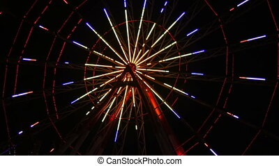 Ferris Wheel Lights at Night. Colorful lights of a Ferris...