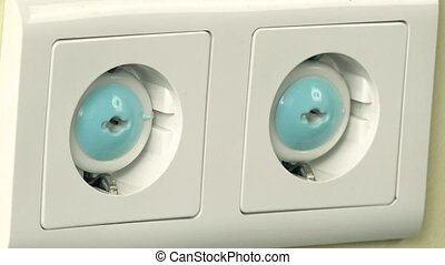 Hand remove safety plug from outlet and insert plug wire -...