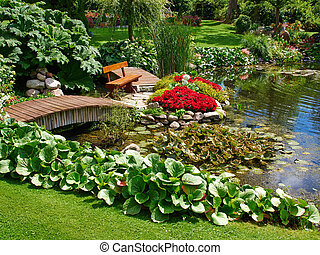 Beautiful classical design garden fish pond with water lily...