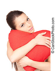 woman with red heart-shaped pillow over white - lovely woman...