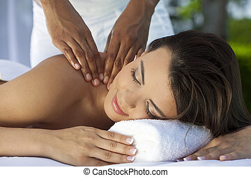 Woman Outside At Health Spa Having Relaxing Massage - A...