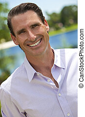 Outdoor Portrait of Handsome Smiling Middle Aged Man - An...