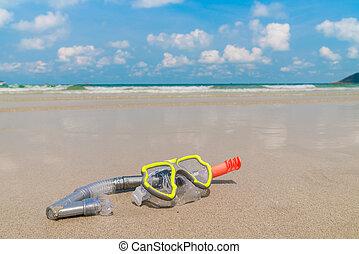 Scuba Diving Equipment On The White Sea Sand Beach